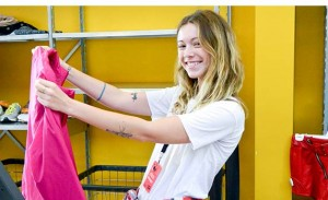 Girl Selecting Clothes for Community Service